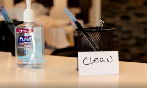 Hand Sanitizer and Pen Holder at Desk of Concord Dental Associates Office